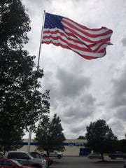Gander Outdoors opened in the spring and then raised a massive American Flag outside its store in July.
