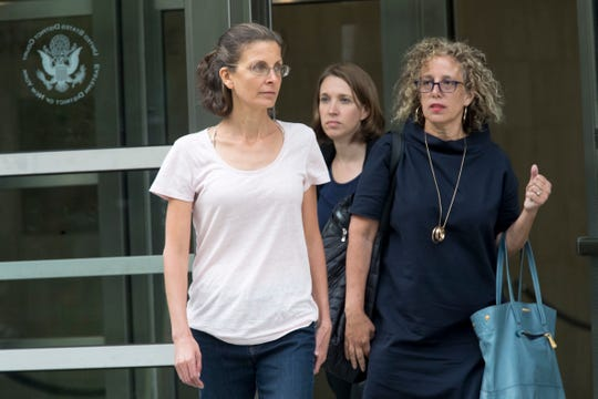 Clare Bronfman leaves federal court, Tuesday, July 24, 2018, in Brooklyn. Bronfman, an heiress to the Seagram's liquor fortune and three other people were arrested on Tuesday in connection with the investigation of a self-improvement organization accused of branding some of its female followers and forcing them into unwanted sex.