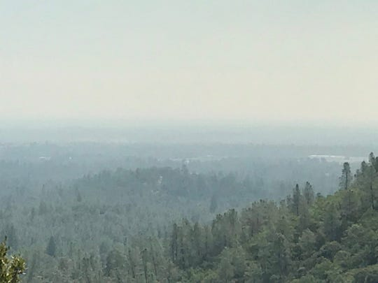 Smoke from Carr Fire blankets the Shasta Dam region on Wednesday, July 25, 2018.