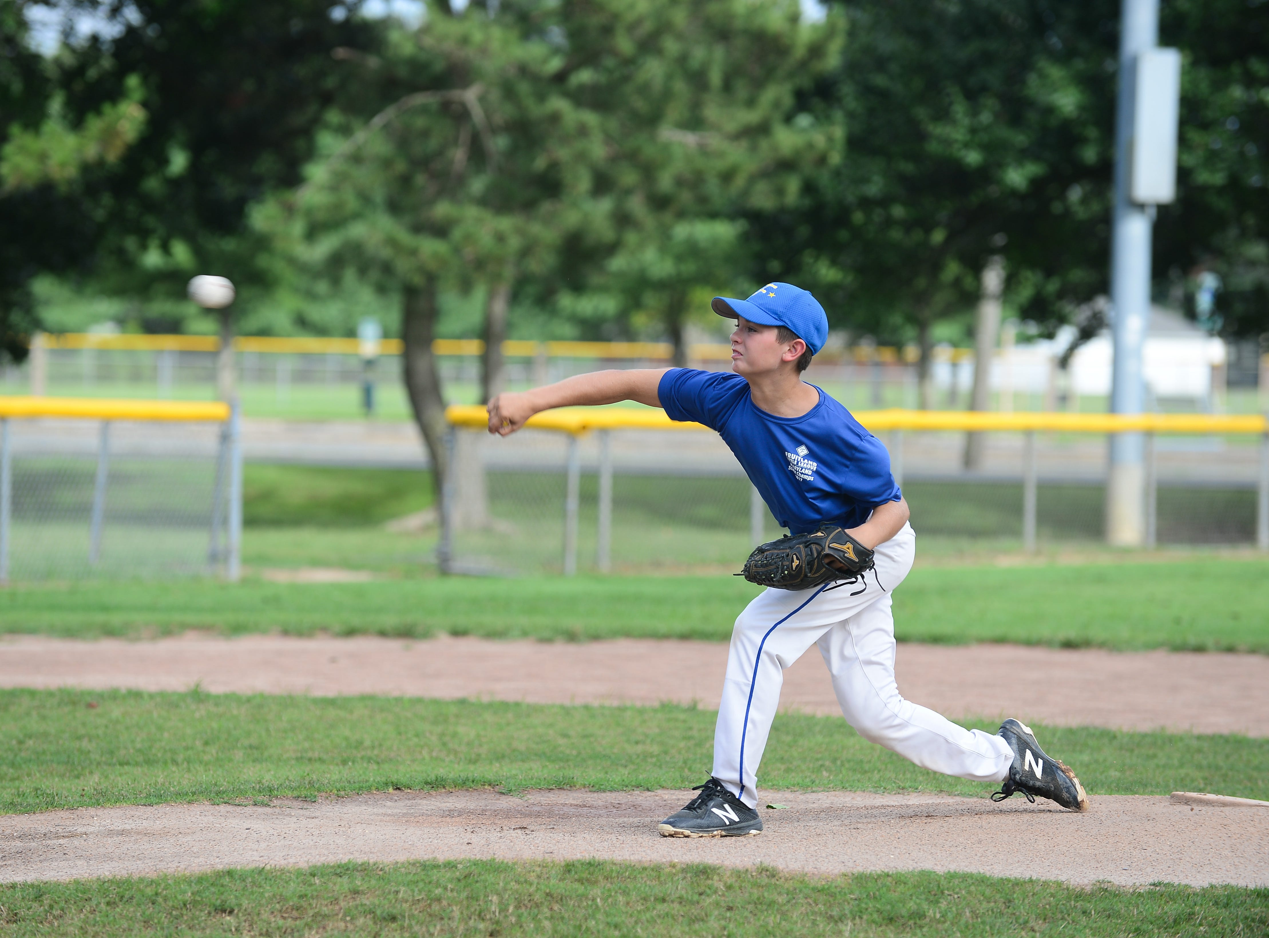 Trevin Whitelock,  a member of the Fruitland Little League 11U team, warms up on the mound on Tuesday, July 24, 2018.