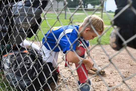 Cole Miles, a member of the Fruitland Little League 11U team, gets ready for practice on Tuesday, July 24, 2018.