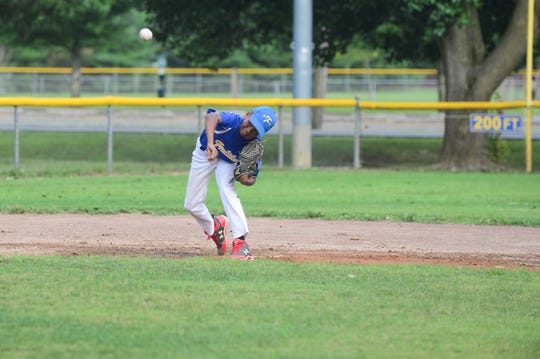Aidan Davis, a member of the Fruitland Little League 11U team, works on drills at short stop during practice on Tuesday, July 24, 2018.