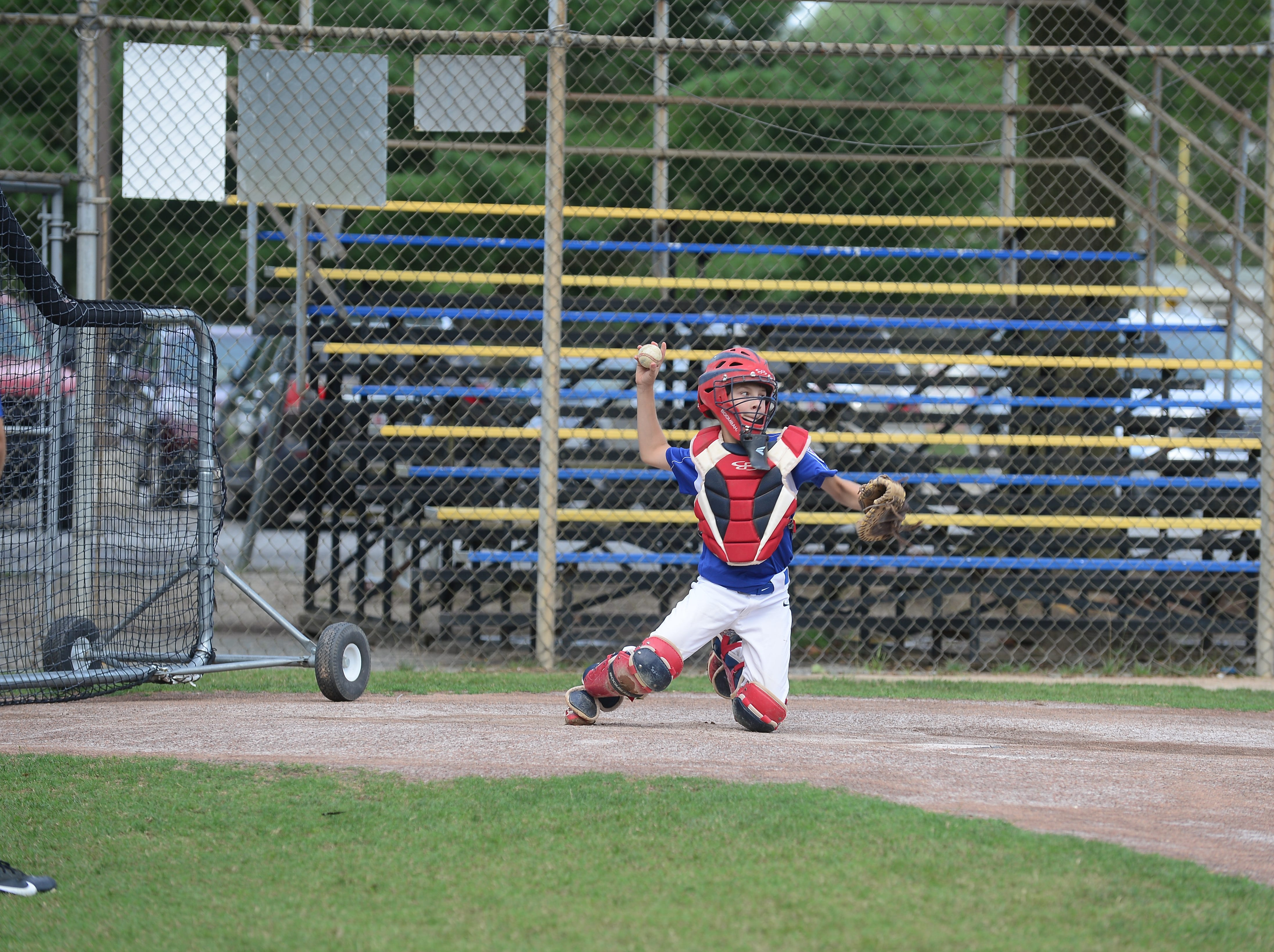 Cole Miles, a member of the Fruitland Little League 11U team, works behind the plate during practice on Tuesday, July 24, 2018.