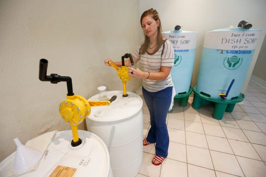 Anne Dezort, operator of The Bulk Soap Refill Station located at 210 S. Campbell Ave., refills dish soap for a customer.