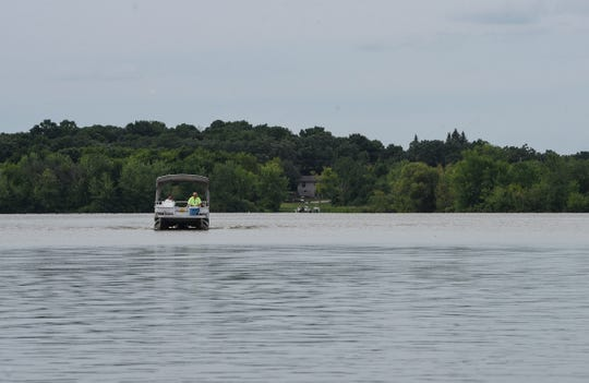 A pontoon boat is driven across Little Rock Lake Wednesday, July 18.