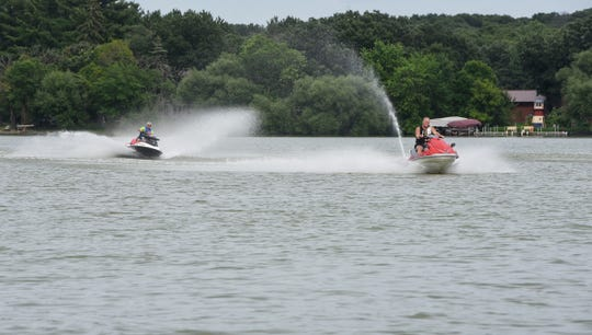 Jet Skis speed across the water Wednesday, July 18, at Little Rock Lake.