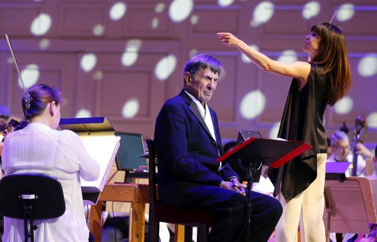 """Leonard Nimoy narrates and Sarah Hicks conducts """"Out Of This World,"""" a program of space-themed music, with the Boston Pops In 2014. Credit Winslow Townson"""