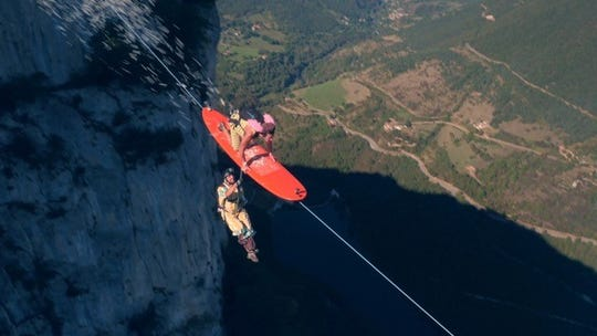 """""""Surf The Line,"""" a short about the Flying Franchise, who zipline across a mountain range and then BASE jump, will be seen at Winter in July at SUMA on July 28, 2018."""