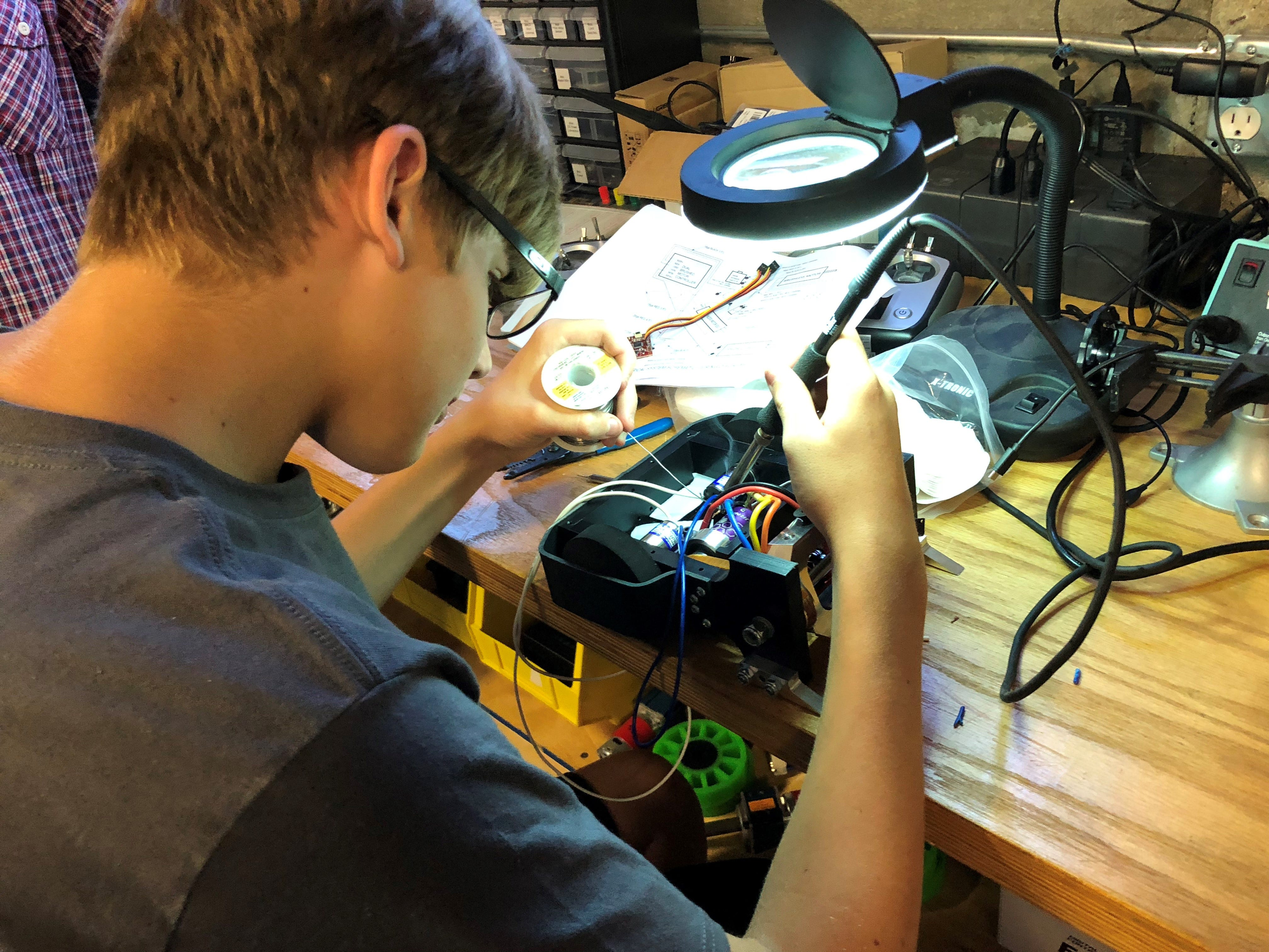 Grant Pitcher working a robot at KurTrox Electronics Engineering and Treasure Coast Makerspace.