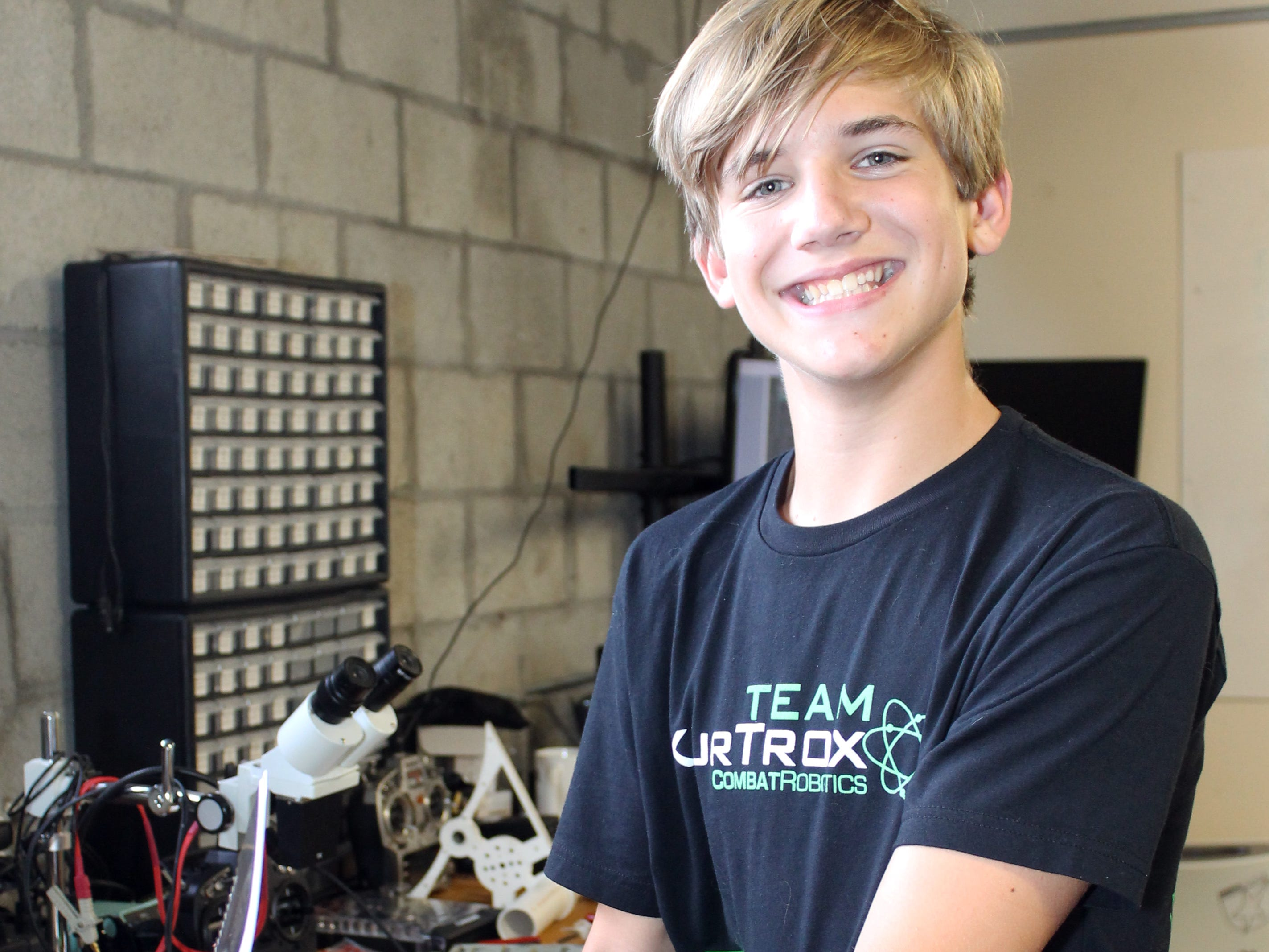 Grant Pitcher with one of his own robot creations at KurTrox Electronics Engineering and Treasure Coast Makerspace.