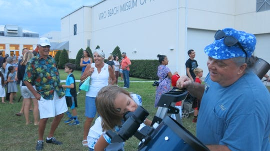 Vero Beach Museum of Art visitors enjoy stargazing through telescopes provided by the Treasure Coast Astronomy Club during the recent Star Party.