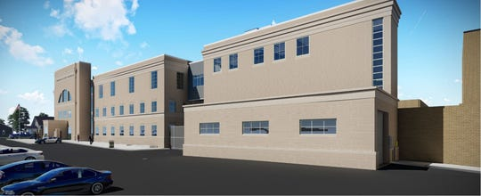 A rendering of the proposed holding facility (right) to be built next to the Cumberland County Courthouse.
