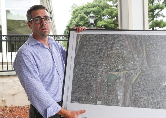 Jonathan Grebow, president and CEO of Ridgewood Real Estate Partners, photographed with a rendering of the proposed Elmwood Preserve at the former Elmwood Country Club in Greenburgh on Wednesday, July 25, 2018.