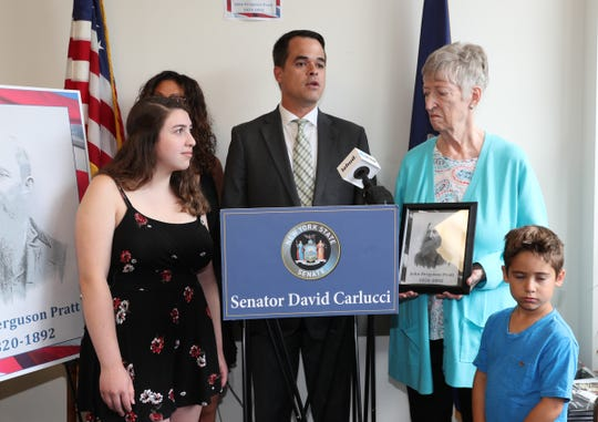 State Sen. David Carlucci, center, presents Viola Silverman, 80, of Sparkill with the Civil War Campaign Medal for the service of her great-grandfather, John Ferguson Pratt at Carlucci's New City office on Wednesday, July 25, 2018. From left, granddaughter Julia Maech, daughter-in-law Melony Silverman, and grandson Jake Silverman.