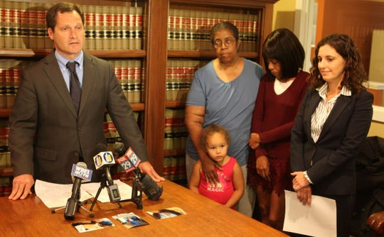 "Jonathan Lowy (left to right) with Cynthis Anderson, Kisha Bailey, Erin Davis and Olivia Summers (front center) announces a lawsuit against Cabela's.  A gun bought through by a straw purchase at the store's site at the Christiana Mall was used in the fatal shooting death of Keshall ""KeKe"" Anderson."