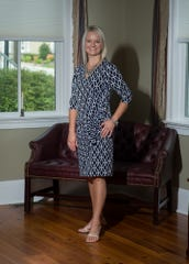 Kristy Rogers wears a black and white dress from New York and Co. with nude high-heel sandals from Rack Room at Tanger Outlets in Rehoboth.