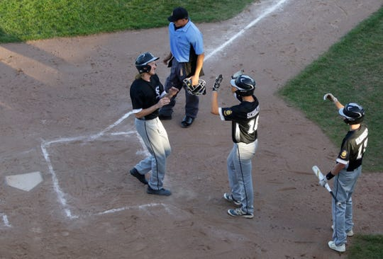 Plover's Mason King (22) celebrates a run with his teammates during the Legion regional title game between the Wisconsin Rapids Rangers and Plover Black Sox at Witter Field in Wisconsin Rapids, Wis. Tuesday, July 24, 2018.