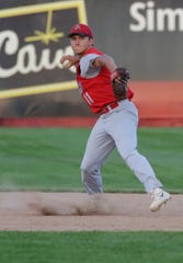 Wisconsin Rapids' Cody Bredl (11) throw to first base during the Legion regional title game between the Wisconsin Rapids Rangers and Plover Black Sox at Witter Field in Wisconsin Rapids, Wis. Tuesday, July 24, 2018.
