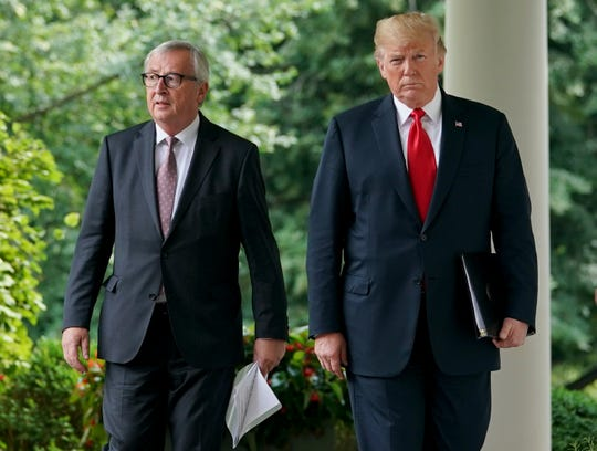 President Donald Trump, right, and European Commission president Jean-Claude Juncker, left, walk from the Oval Office to speak in the Rose Garden of the White House, Wednesday, July 25, 2018, in Washington. (AP Photo/Pablo Martinez Monsivais) ORG XMIT: DCPM112