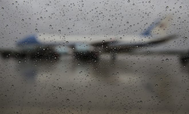 Air force One carrying President Donald Trump is seen through a rain soaked window as it prepares to depart on July 24, 2018  from Joint Base Andrews, Md.  Trump is traveling to Kansas City to speak veterans after the confirmation of his new Veterans Affairs Secretary, Robert Wilkie.