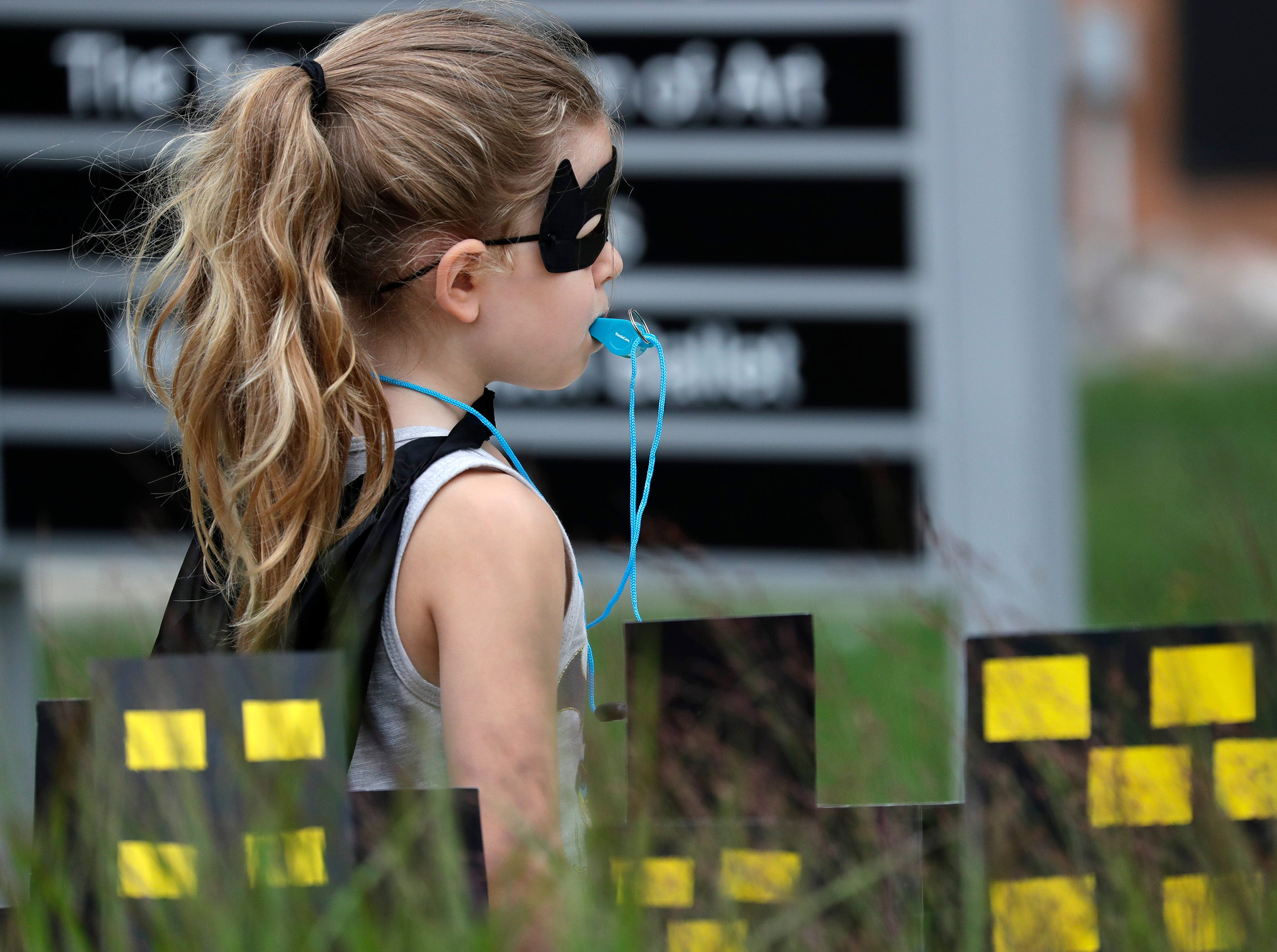 Harper Wundrow, 5, of Appleton, blows a whistle while waiting for the 10th annual ChildrenÕs Parade to start Wednesday, July 25, 2018, in Appleton, Wis. Danny Damiani/USA TODAY NETWORK-Wisconsin