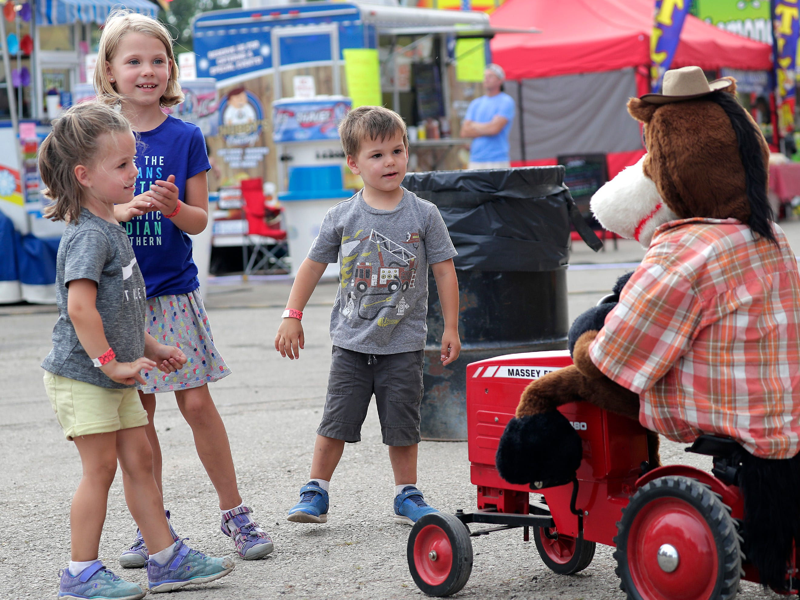 Marlee, left, and Scarlett, center and Fischer Wallerich during the Outagamie County Fair on Wednesday, July 25, 2018 in Seymour, Wis. 