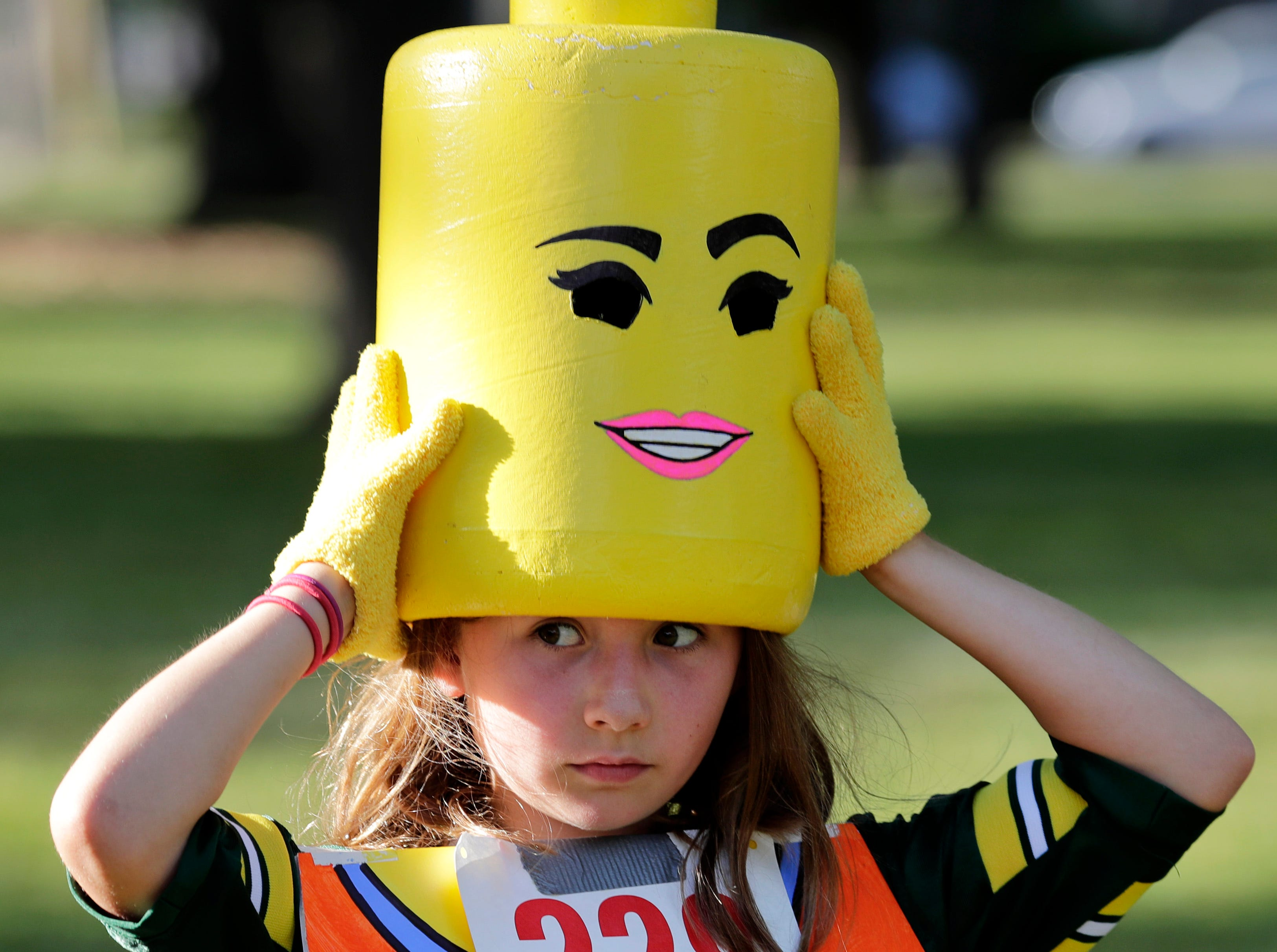 Ada Vieaux, 9, of Appleton, puts her Lego hat back on after the 10th annual ChildrenÕs Parade Wednesday, July 25, 2018, in Appleton, Wis. Danny Damiani/USA TODAY NETWORK-Wisconsin