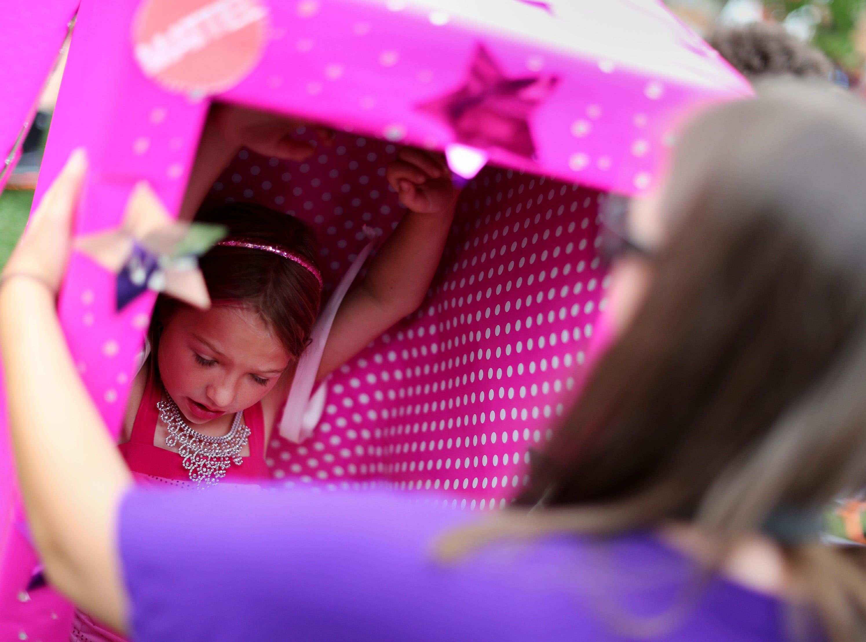 Sarah Burt helps her daughter Hailey, 7, get into her Barbie box costume during the 10th annual ChildrenÕs Parade Wednesday, July 25, 2018, in Appleton, Wis. Danny Damiani/USA TODAY NETWORK-Wisconsin