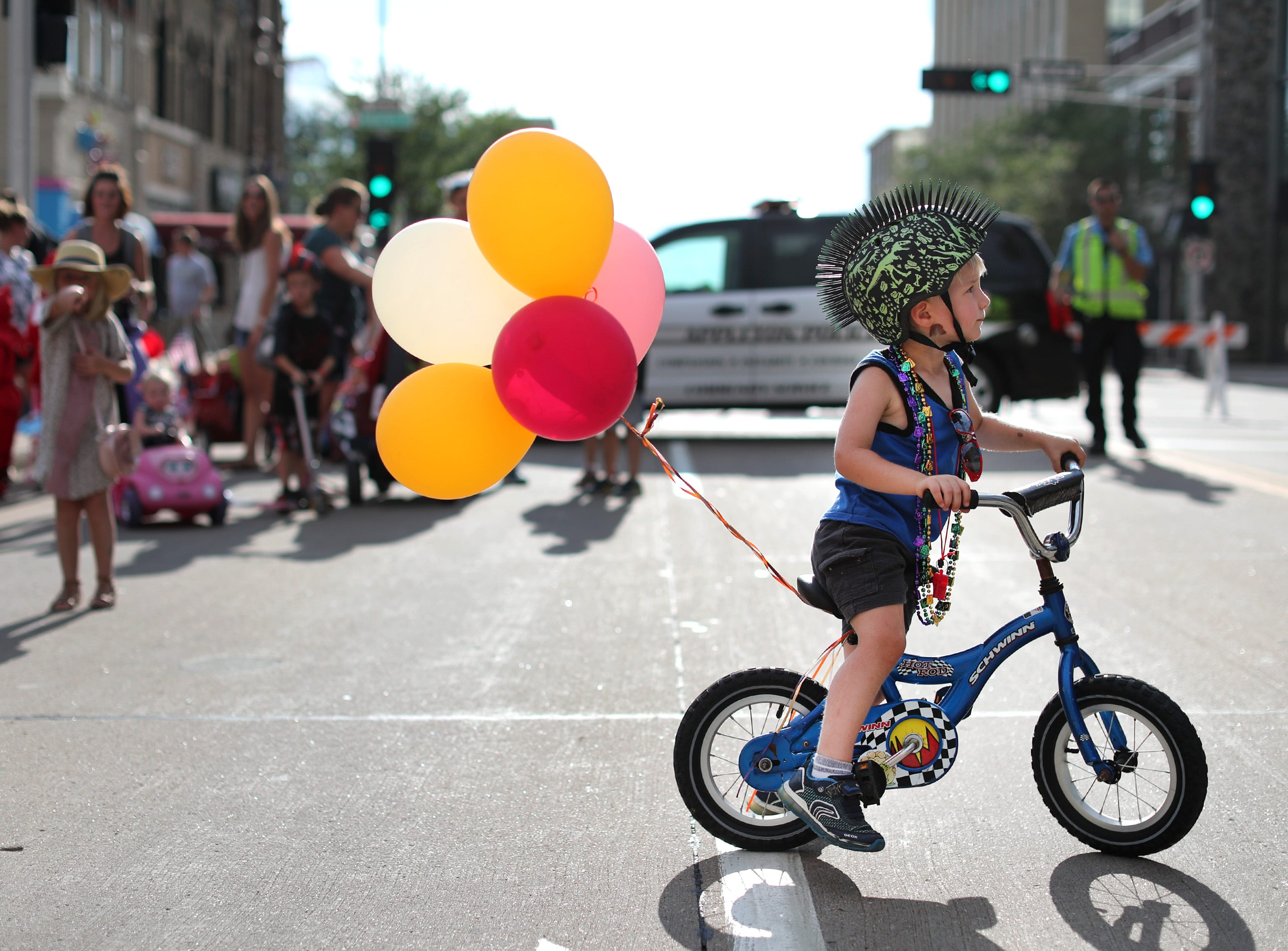 Hugo Wells, 3, of Appleton, gets ready for the 10th annual ChildrenÕs Parade Wednesday, July 25, 2018, in Appleton, Wis. Danny Damiani/USA TODAY NETWORK-Wisconsin