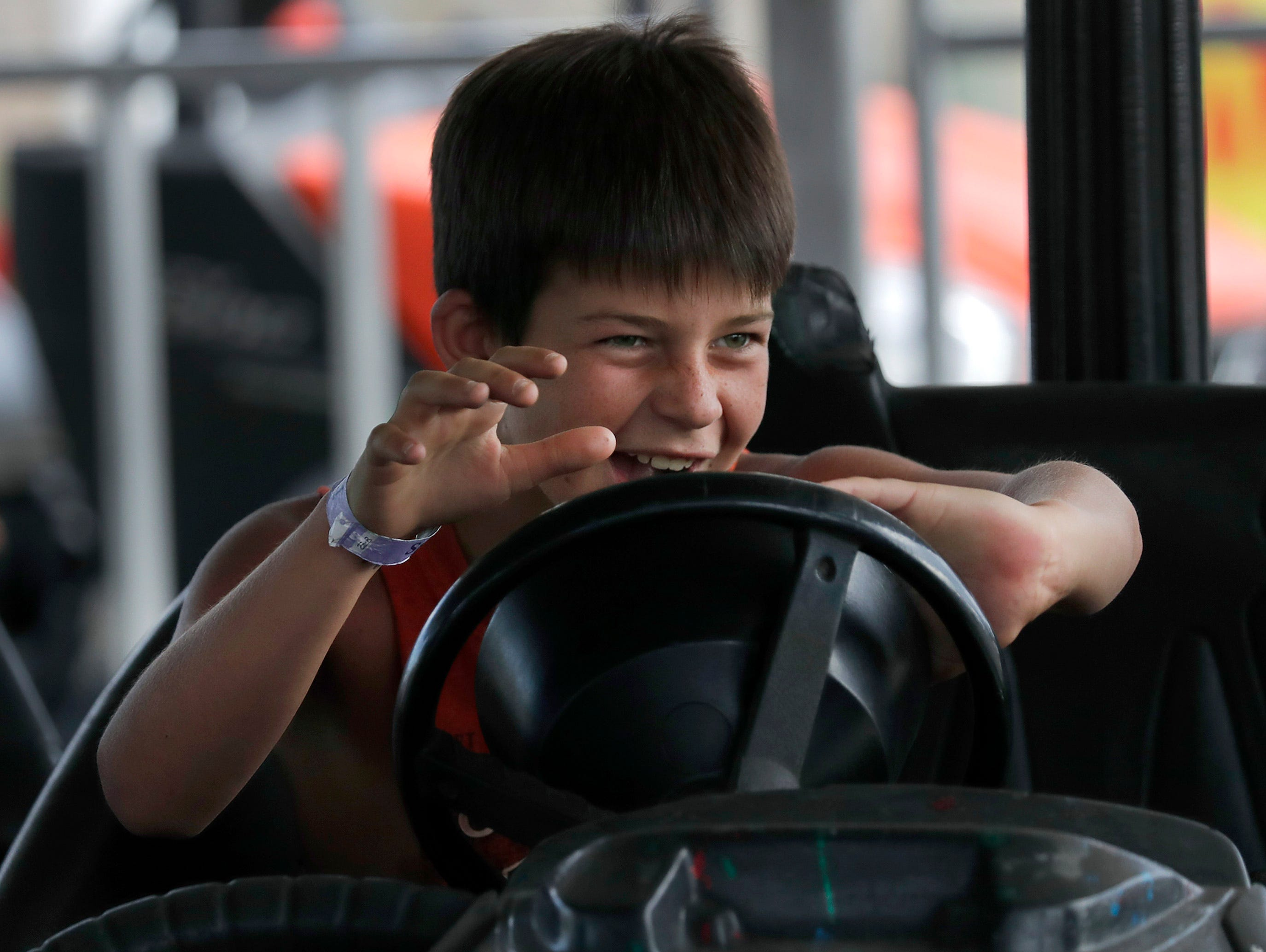 Wyatt Bemis, Crivitz, drives a bumper car during the Outagamie County Fair on Wednesday, July 25, 2018 in Seymour, Wis. 