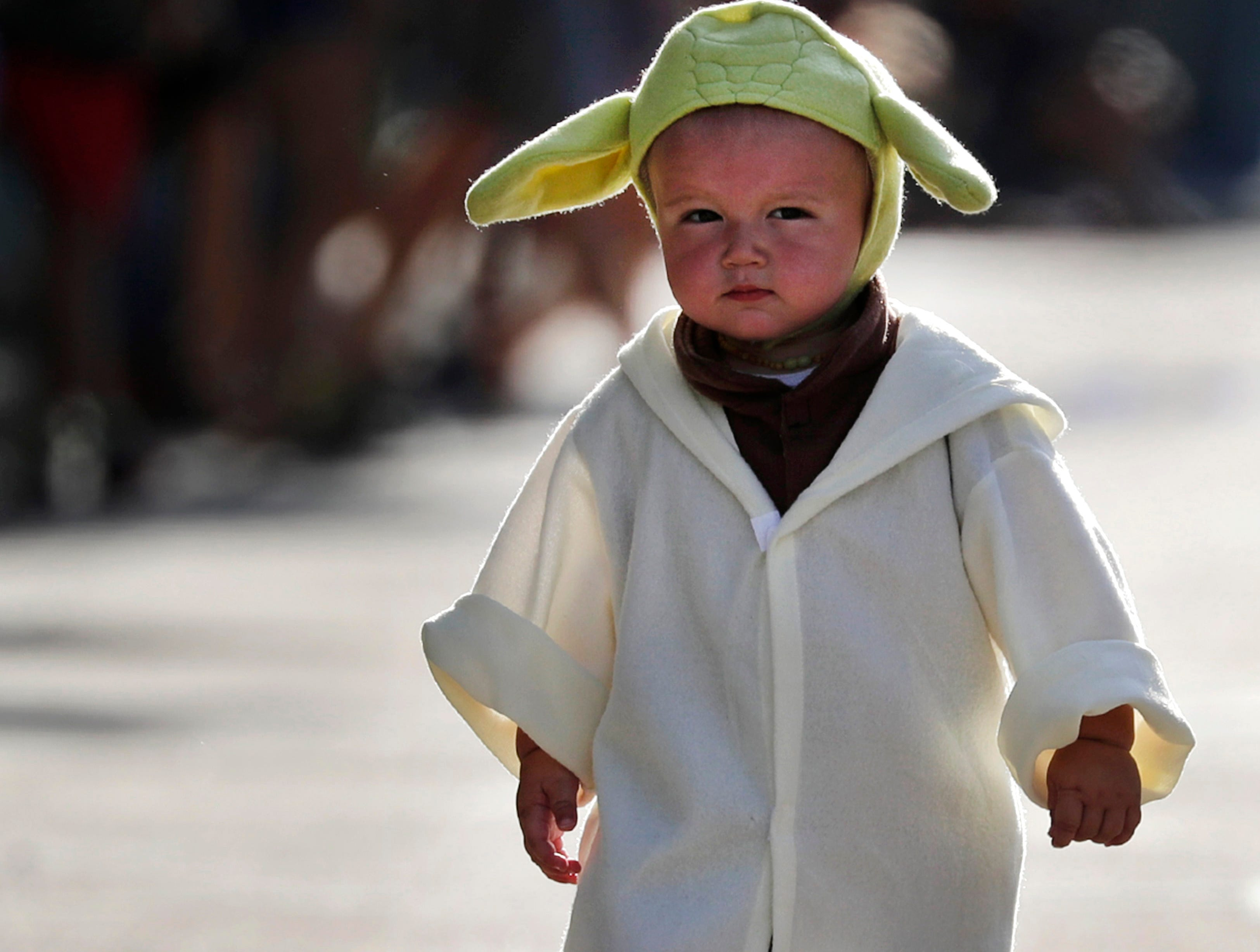 Theo Slye, 16 months old, makes his way down college avenue dressed as Yoda during the 10th annual Children's Parade Wednesday, July 25, 2018, in Appleton, Wis. Danny Damiani/USA TODAY NETWORK-Wisconsin