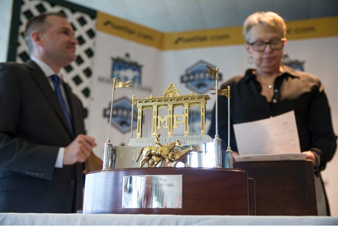 Monmouth Park officials hold a post position draw press conference for the betfair.com Haskell Invitational which will take place on Sunday, July 29th. John Heins, director of racing and racing secretary and Lynn Ott, stakes coordinator, pull names for the draw.