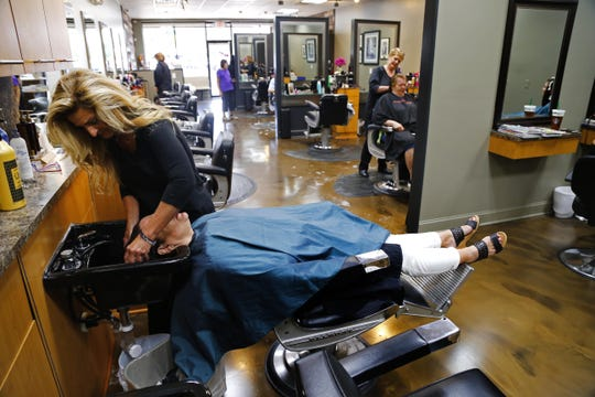 Owner Lori DeFalco works with a client at Style Salon and Barber in Freehold Township.