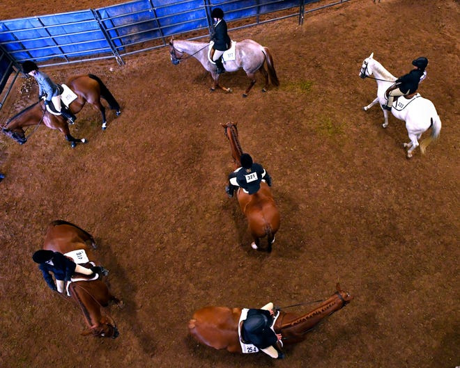 Riders warm up their horses Thursday before the Hunter Under Saddle competition at the 2018 Texas State 4-H Horse Show at the Taylor County Coliseum.