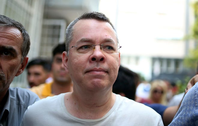 Andrew Brunson, an evangelical pastor from Black Mountain, arrives at his house in Izmir, Turkey, Wednesday while being escorted by Turkish police.