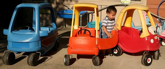 Carter Dinel, 1, exits one of the toy cars on the playground of the Marion Forsman-Boushie Early Learning Center in Poulsbo. The number of child care slots in Kitsap County has decreased while demand for care has increased.