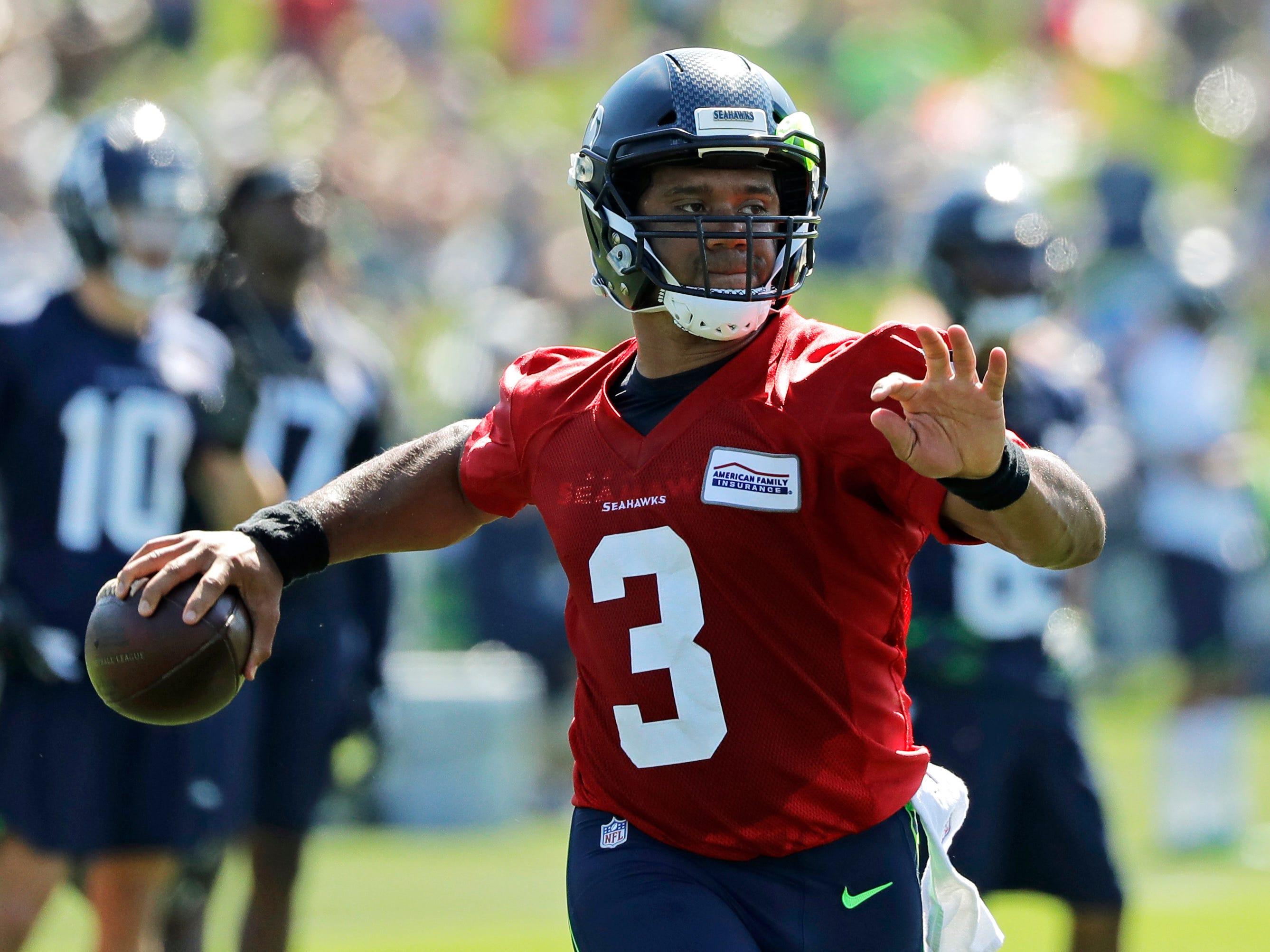 Seattle Seahawks quarterback Russell Wilson (3) passes during NFL football training camp, Thursday, July 26, 2018, in Renton, Wash. (AP Photo/Ted S. Warren)