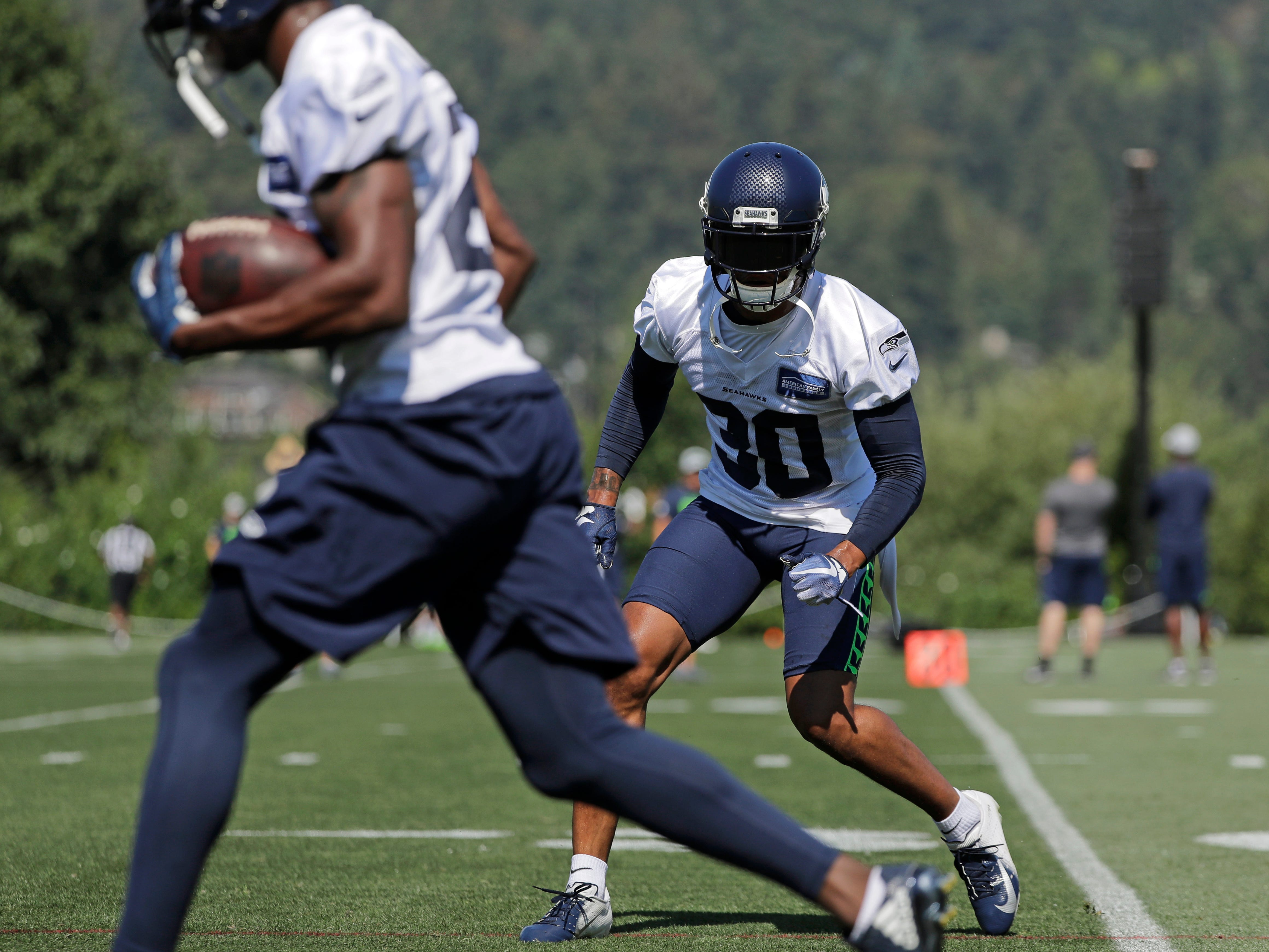 Seattle Seahawks strong safety Bradley McDougald (30) tracks a teammate with the ball during NFL football training camp, Thursday, July 26, 2018, in Renton, Wash. (AP Photo/Ted S. Warren)