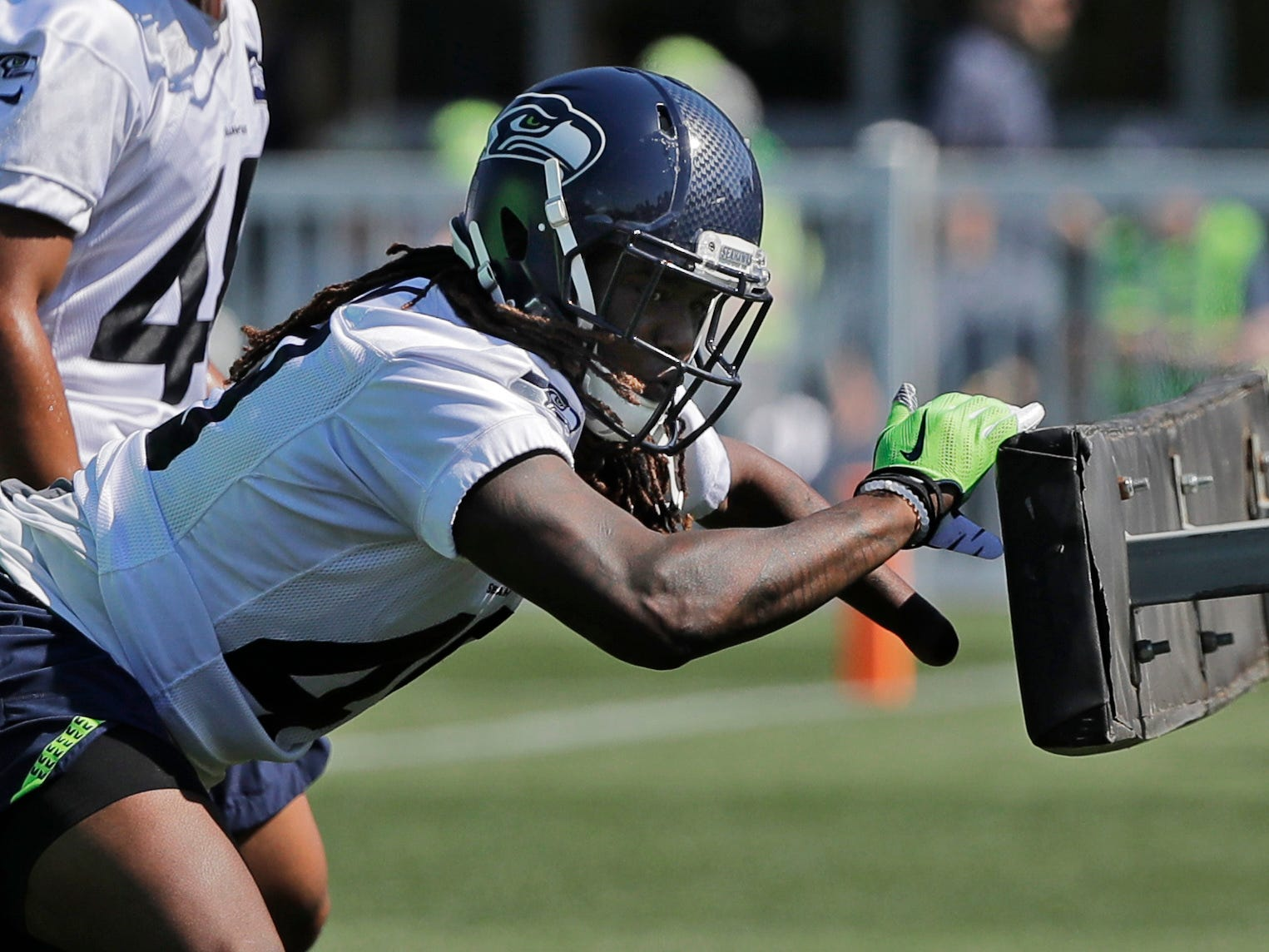 Seattle Seahawks linebacker Shaquem Griffin hits a blocking sled during NFL football training camp, Thursday, July 26, 2018, in Renton, Wash. (AP Photo/Ted S. Warren)