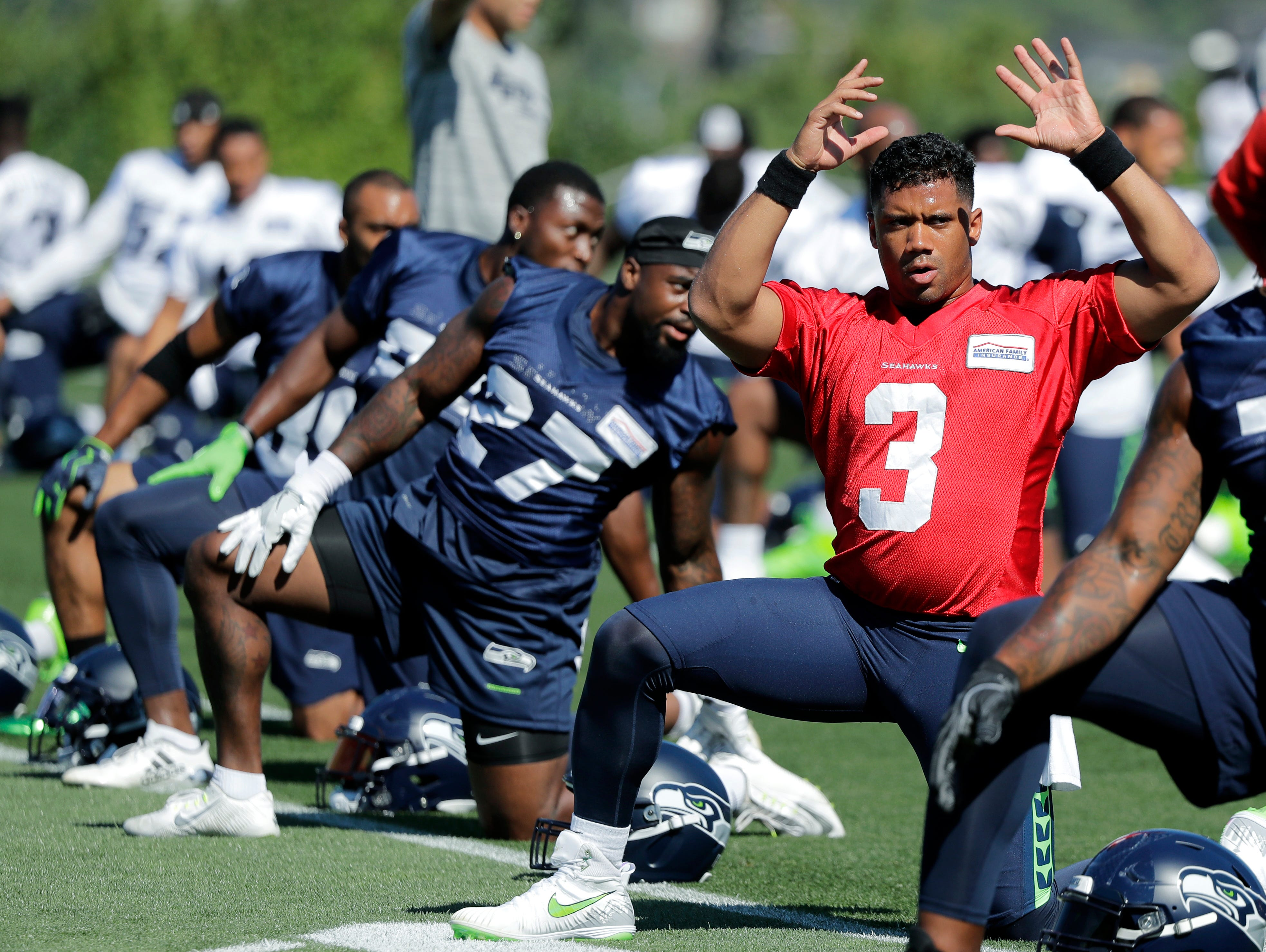 Seattle Seahawks quarterback Russell Wilson (3) stretches during NFL football training camp, Thursday, July 26, 2018, in Renton, Wash. (AP Photo/Ted S. Warren)