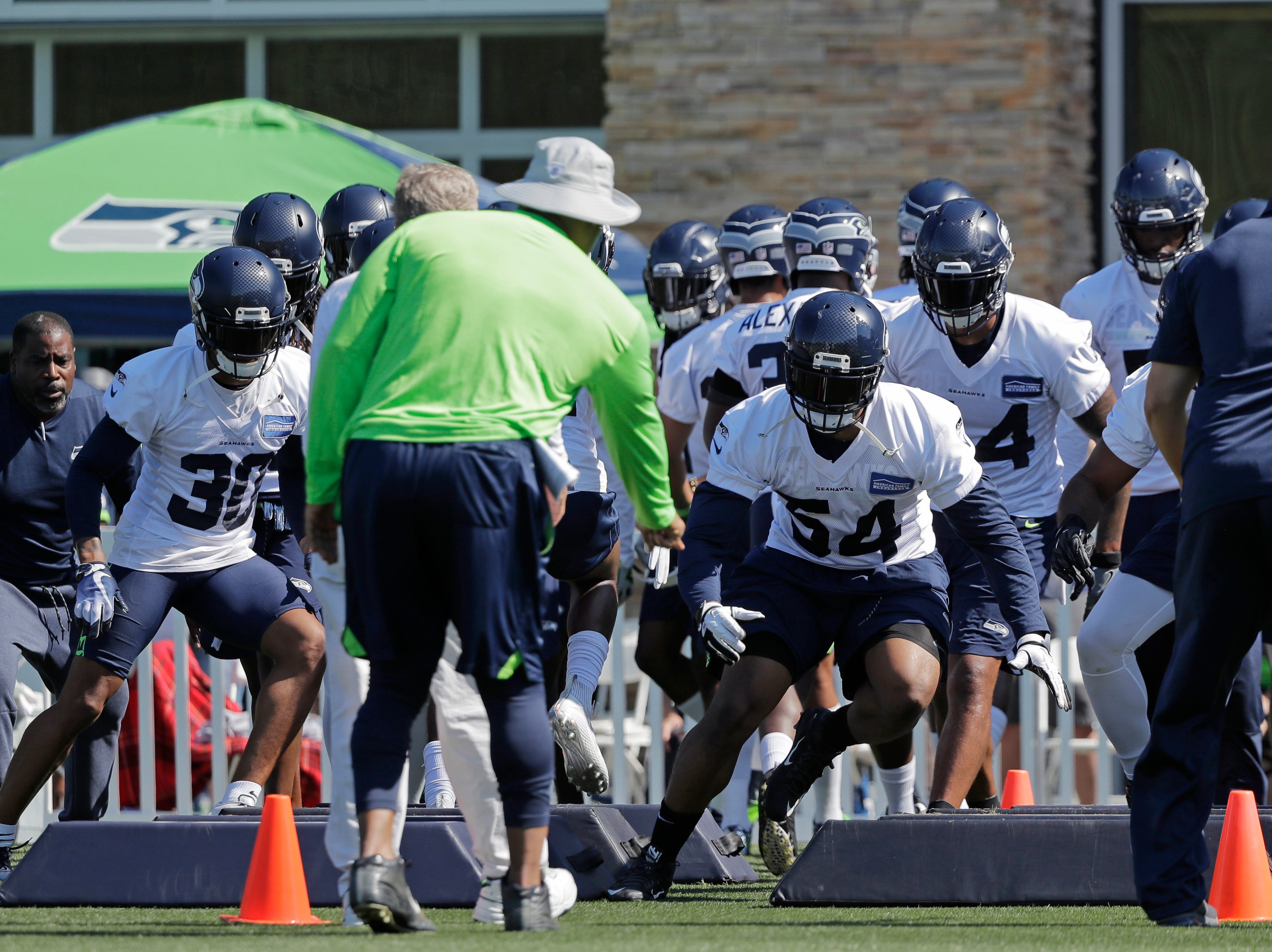 Seattle Seahawks strong safety Bradley McDougald (30) and linebacker Bobby Wagner (54) run an agility drill with teammates during NFL football training camp, Thursday, July 26, 2018, in Renton, Wash. (AP Photo/Ted S. Warren)