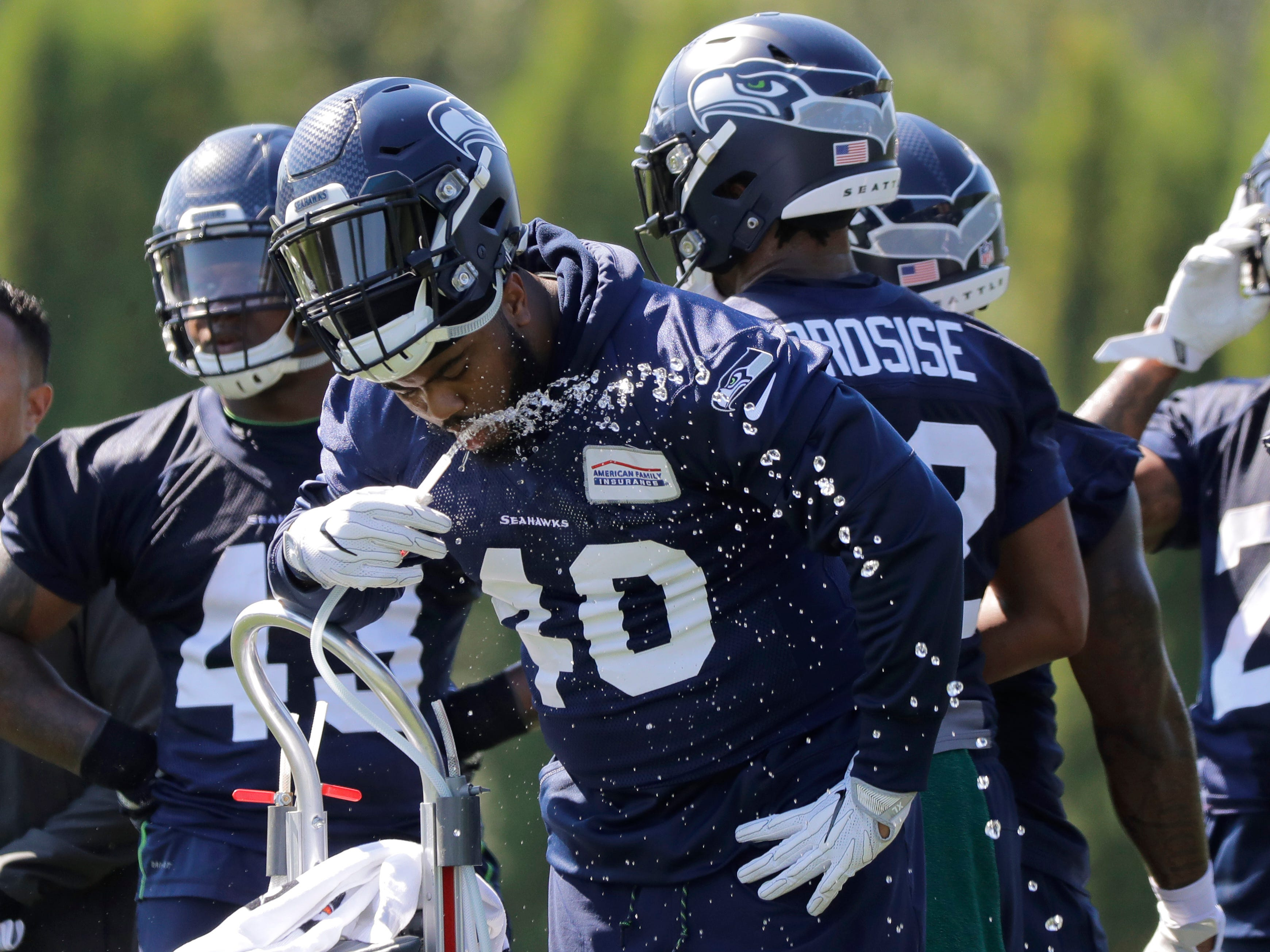 Seattle Seahawks fullback Khalid Hill (40) drinks water during NFL football training camp, Thursday, July 26, 2018, in Renton, Wash. (AP Photo/Ted S. Warren)