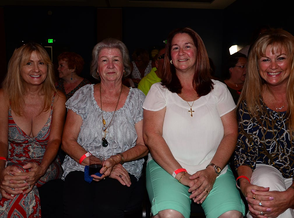 These lovely ladies sit ready to begin the Men on Fire benefit Saturday evening in Viera. Peggy Apr, Margaret Derouen, Cindy Derouen, and Michelle Nicholas.
