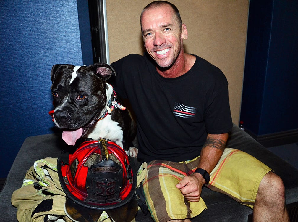 Allie Newell, one of the Men on Fire entertainers, and one of the dogs to benefit from the SPCA event held Saturday night in Viera.