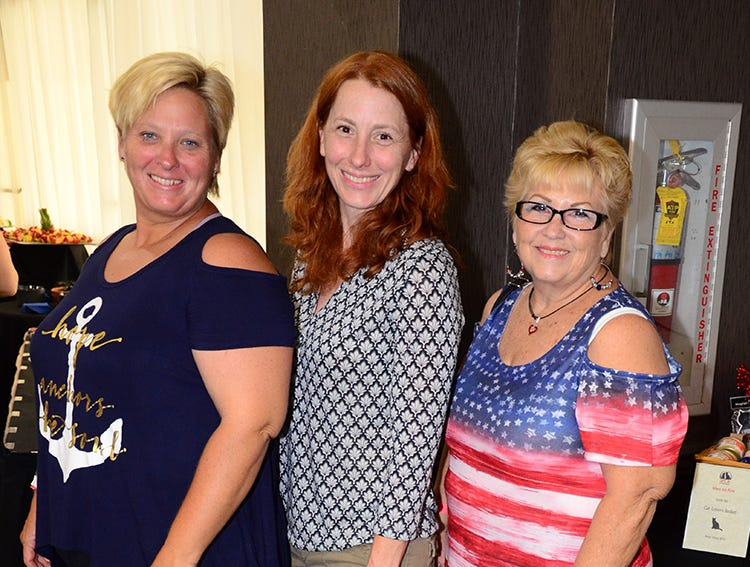 Arriving for the Men on Fire SPCA benefit Saturday evening were Angela Vice, Michelle Vice and Carol Peavey.