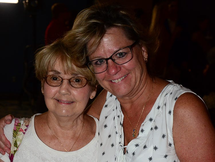 Stopping to pose for the camera Saturday evening were Maria Walters and Debbie Hambel who both attended the Men on Fire benefit for the SPCA held at the Holiday Inn, Viera.