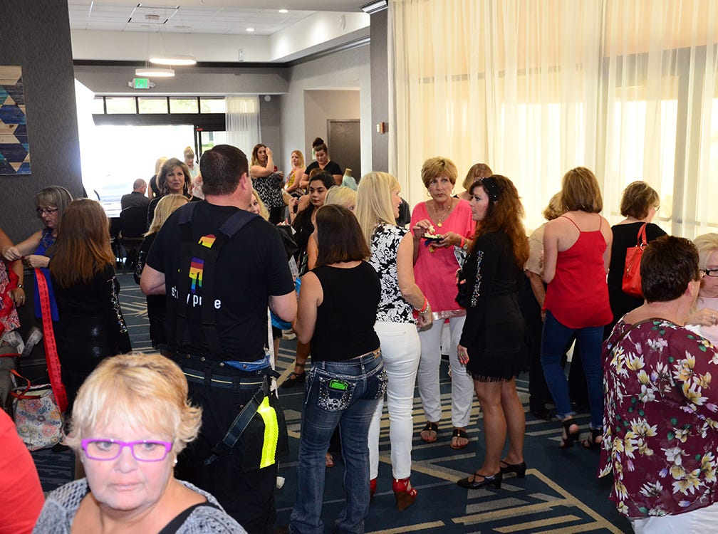 Men on Fire patrons mingle Saturday evening before the SPCA benefit began at the Holiday Inn in Viera.