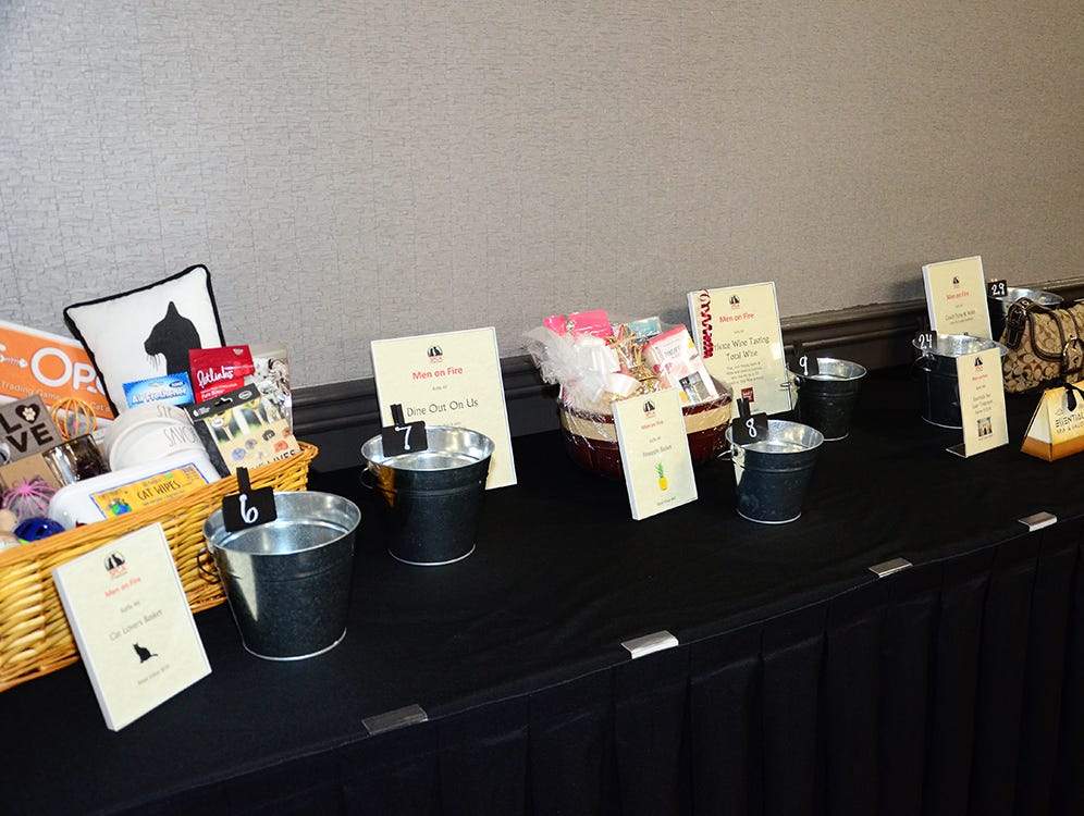 Some of the items up for silent auction during the Men on Fire SPCA benefit held Saturday evening in Melbourne.