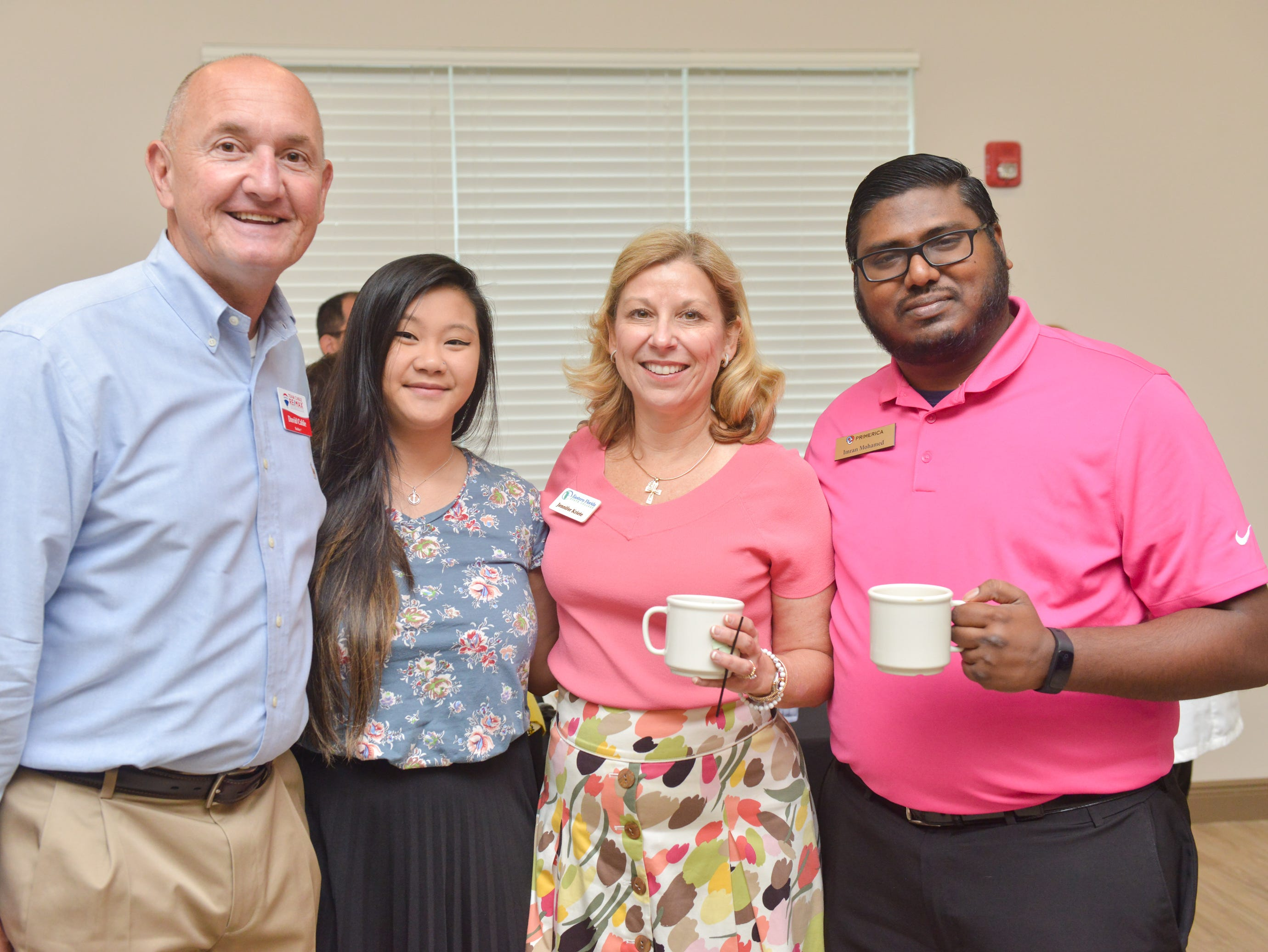 David Cable, Thao Trann, Jennifer Kriete and Imran Mohamed during the Women of Excellence Gathering at Promise in Brevard sponsored by the Melbourne Regional Chamber.