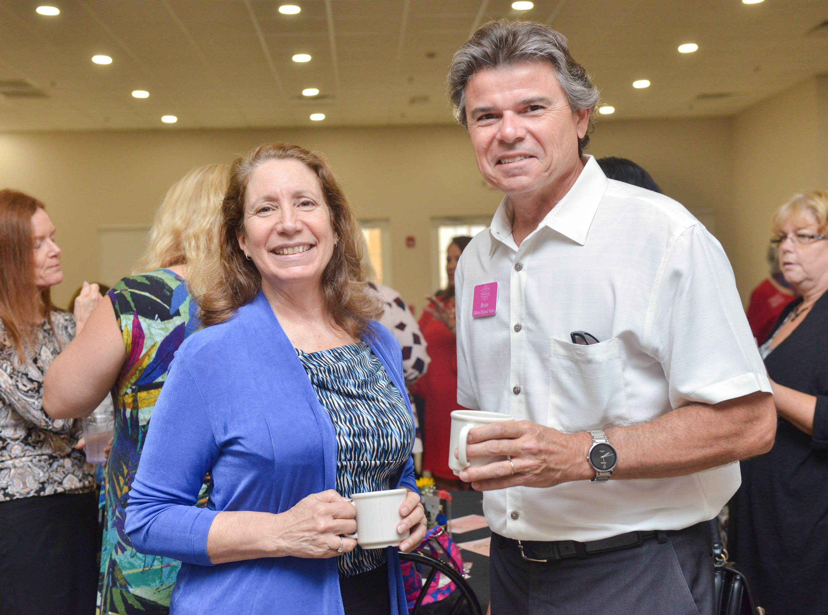 Mary Dyer and Brian Dillon during the Women of Excellence Gathering at Promise in Brevard sponsored by the Melbourne Regional Chamber.